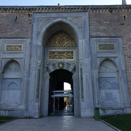 """The Imperial gate(built in 1478 AD) is the outermost gate and served as a main entrance to the Topkapi palace. The Imperial gate opens into the first courtyard of the palace, where royal Ottoman ceremonies used to take place. The gate bears an Arabic inscription on the top. Constructed in the 1460s AD, after the conquest of Constantinople(present day Istanbul) in 1453 AD by """"Mehmet the conqueror"""", Topkapi palace served as the Ottoman sultans' royal residencial & official complex for 400 years."""