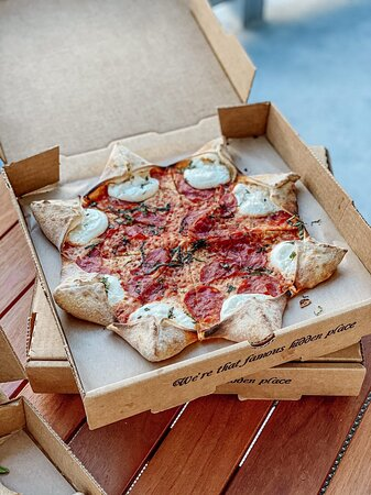 Star Luca Pizza - Star shaped pizza filled with ricotta cheese, spicy salami, mozzarella, italian tomato sauce and basil