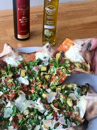 Star Carlos-Star shaped pizza filled with ricotta cheese, mozzarella, chorizo sausage, tomatoes, arugula, avo, Italian parmesan and jalapeño