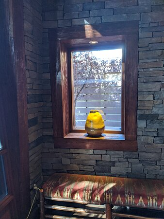 Single golden pot on a window at the Lazy Dog restaurant.