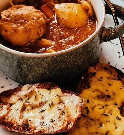 Chicken Stew with Dumplings and freshly baked Sourdough toasted with melted cheddar cheese on top.
