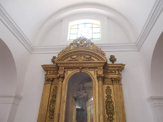 The shrine featuring a saint holding a child (on one side along the length of the Cathedral)