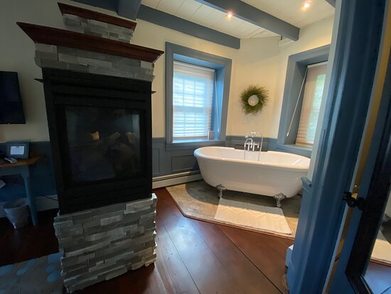 Fireplace and tub in Blue Me Away