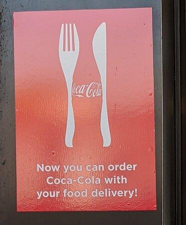 Coca-cola with food delivery from Tacos El Tio .