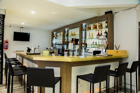 Our Bar/Restaurant is the best place to hangout, meet new pals, watch football, listen to good music, and even get some work done. There's room for each person to follow his own path; socialize, graze, dine or drink.
