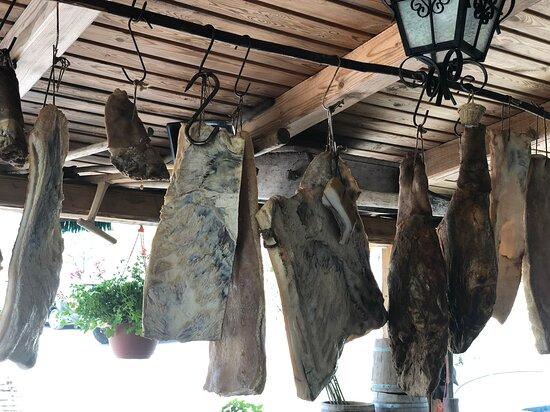 Lika-Senj County, Croatia: Lika, Croatia - Locals drying prosciutto and bacon
