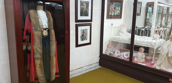 Millicent National Trust Museum   SA   Mayoral robes with baby wear in background