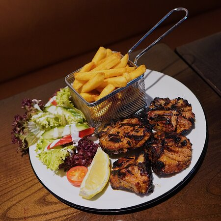Grilled lamb chops with a side of fries