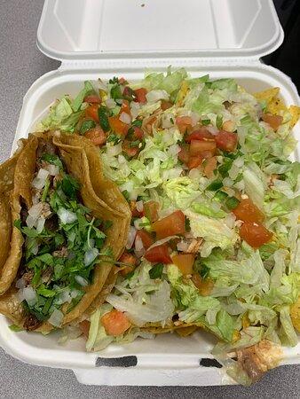 Tinga nachos plus a Carnitas taco