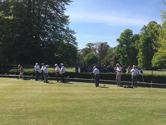 Bowlers enjoying a game of bowls in the sunshine.