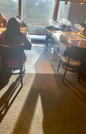 """Table that were were removed from because it was """"broken"""" yet as we exited a new party was seated there."""