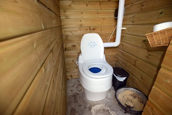 Compost toilet (intelligent Swedish system with continuous air extraction) right near the Apple Wagon; main bathroom down the main farmhouse