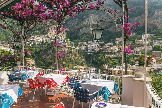 Tables under a bougainvillea roof