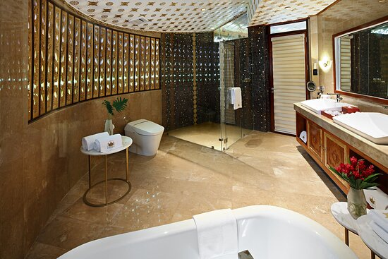 The villas' marble bathrooms undeniably speak luxury. Each bathroom is adorned with 24-karat gold mosaic tiles and is furnished with deep soaking tubs, glass-enclosed showers, complemented with Molton Brown bath amenities.