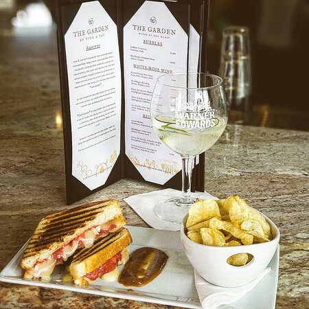 Not only do we have delicious drinks we have delicious food and snacks available daily. Pictured here is our truffle grilled cheese with local mango jam.