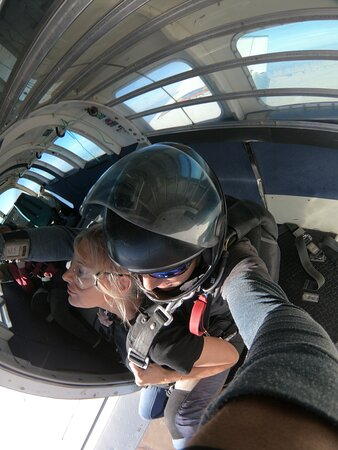 Getting ready to scoot out of that plane at 18,000 feet with my tandem instructor, Justin!