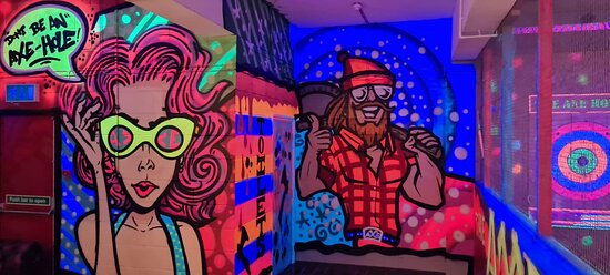 Fantastic vibrant graffiti area complete with our axe house mascot.