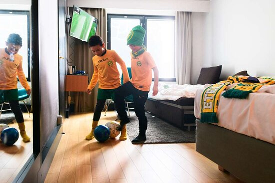Children Playing Soccer in Room