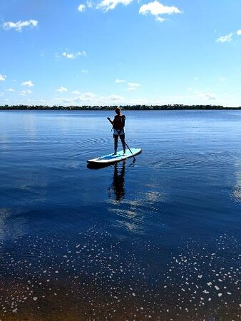 Paddle boarding on the river.