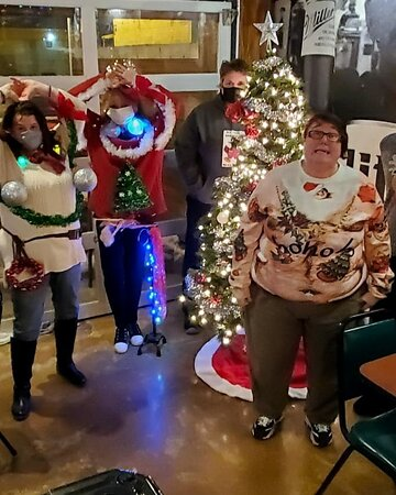 Meet Drea our newest bartender with a cold Amberbock followed by Ugly sweater winner and runners up, Lindsay and James in rare form