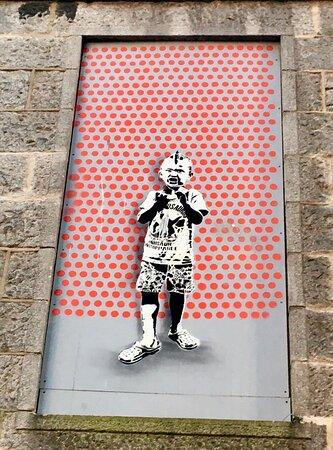 Aberdeen, UK : Banksy-style artwork decorating windows in the NetherKirkgate area.