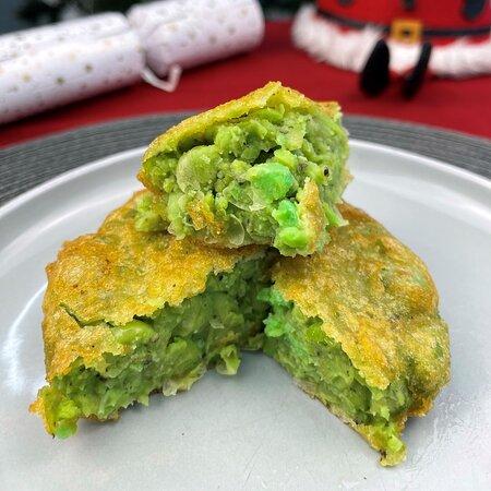 Handmade pea fritter seasoned with salt, pepper & a dash of mint sauce