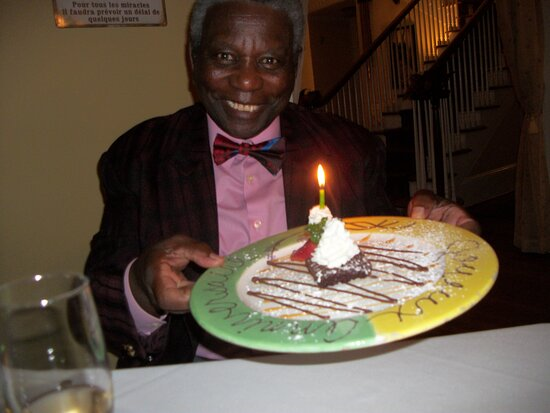 originally he had passed on dessert but was surprised with a lil birthday dessert. he was pleased!