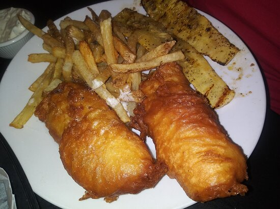 Large portion of delicious battered cod with yummy fries and grilled squash.  Perfectly cooked and delicious.