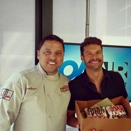 Ryan Seacrest Enjoying The Big Poppa Tart Donut!