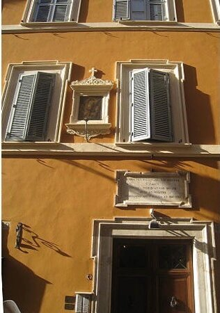 Detail of the hostel and the plaque above the door