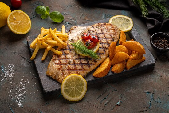 Hammour Grilla Creamy white hammour fillet grilled with roasted cherry tomato, mushroom, diced potato in oyster creamy sauce.   Served with 2 of the following side dishes, mashed potato, French fries, potato wedges, baked potato, sautéed mixed vegetables, grilled vegetables and Soft Drink