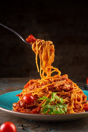 Spaghetti Polpette di Carne (Meatballs) Spaghetti pasta with our famous herbs blended stuffed meat balls, topped with tomato sauce, parmesan cheese.