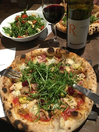 Turkey bacon stuffing cranberry Gorgonzola and SPROUTS upon a delicious hand pulled base. You are looking at the best pizza combo ever!