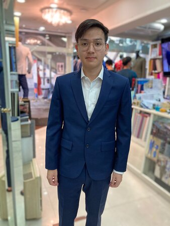 A young graduate getting ready for his ceremony with a tailored nice suit