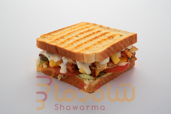 Tosta with fresh iceberg fresh tomato pickle fries and juicy chicken with coriander sauce make your mouth juicy with amazing taste SHAWARMA56 YOU ARE BEST IN KSA....