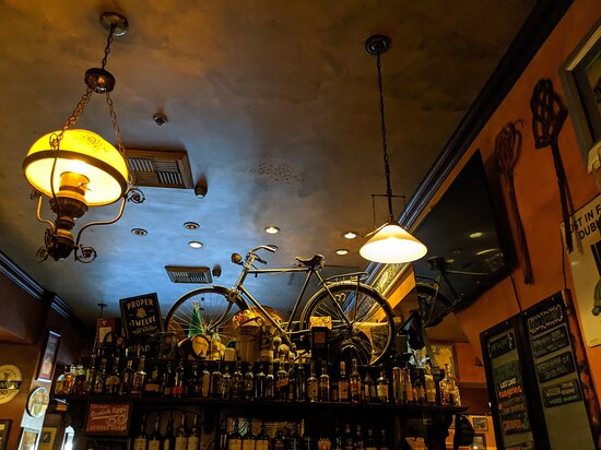 Bicycle over the front pub bar at The Auld Dubliner.
