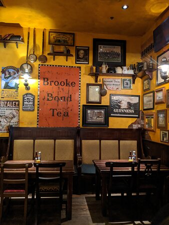 Seating by the brook bond Tea Sign at The Auld Dubliner.