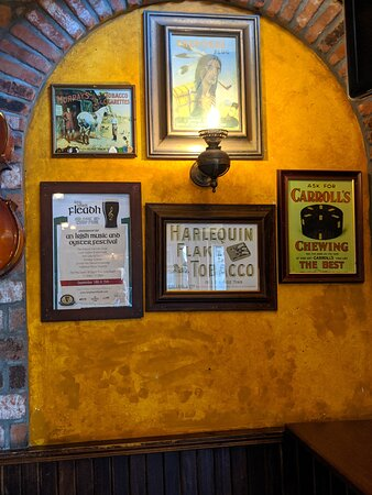 Tobacco sign and more on the wall at The Auld Dubliner.