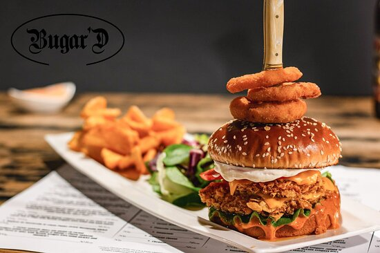 Crispy chicken burger, butter, american cheese, mayonnaise, american deep sauce, tomato with McCain crispers fries, onion rings and american deep sauce 300/200 g