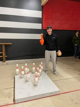 """Try football bowling! Travis Foess got a rare """"bonk"""". He was able to knock only the center pin down on his first throw!"""