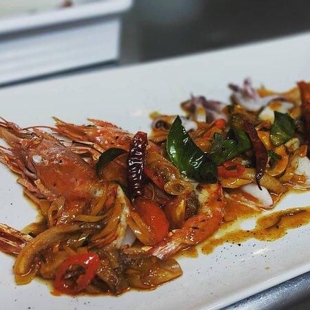 Grilled seafood in stir-fried Tom-Yum