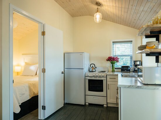 Kitchen and Bedroom of Yellow Door Glamping Cottage