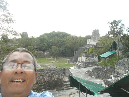 """At the top of the high-ground structures on the north side of Gran Plaza (after coming up its """"wide terrace-like"""" steps & also regular stone steps)"""