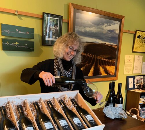 Rosie pouring tasting samples at our Cellar Door.