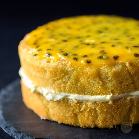 Our Passion Paradise adding some freshness to your Tuesday morning!   Soft sponge cake layered with a light citrusy buttercream and topped with our tangy passion fruit drizzle 😋😋  Call us on 0777382510 for orders and inquiries!