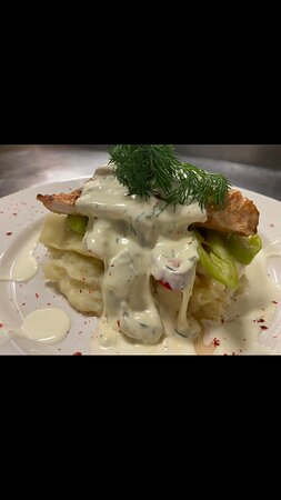 Chicken Supreme, with a white wine and mushroom sauce served on a bed of mashed potato