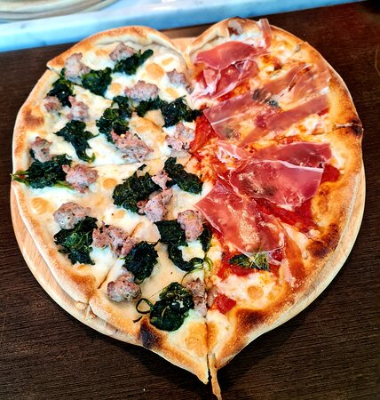 """Have a """"Heart"""", customized half sausage and spinach, half Parma ham. Bellisimo!"""