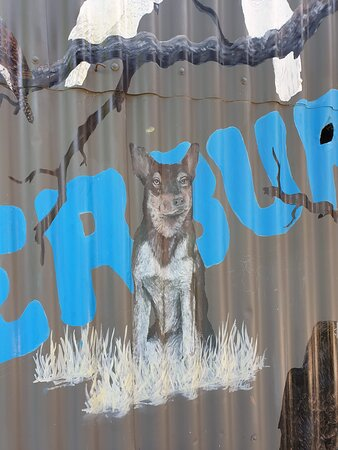 Kelpie, popping out of a larger artwork.