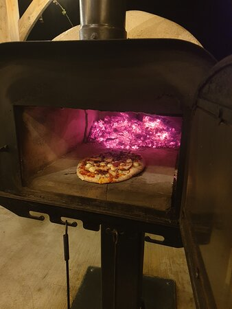 Wood fired pizza oven in The Hub.