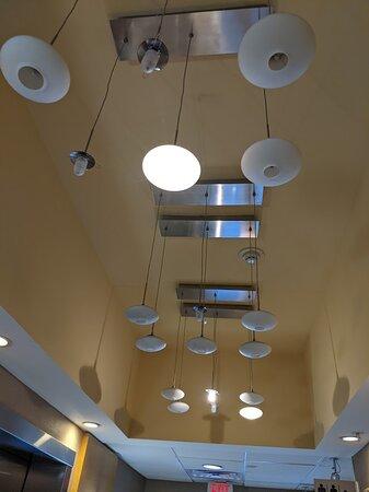Ghetto light fixture in elevator lobby.